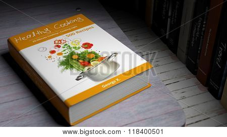 Hardcover book on Healthy Cooking with illustration on cover, on wooden surface.