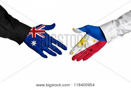 Australia and Philippines leaders shaking hands on a deal agreement