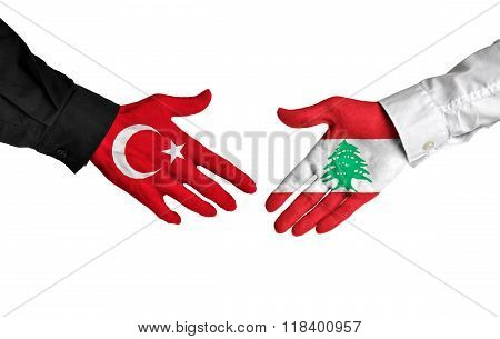 Turkey and Lebanon leaders shaking hands on a deal agreement