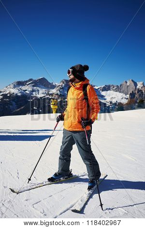 skier standing on the ski slope and looking somewhere