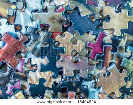 Background of scattered colorful puzzle pieces