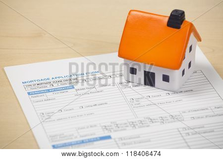 Mortgage application form with foam house on top