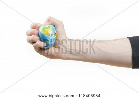 Global issues concept, hand grips world globe stress ball