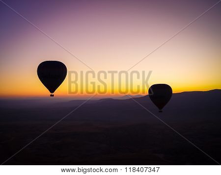 Hot Air Balloons Flying Over Cappadocia At Sunrise.
