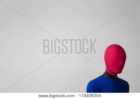Surrealism Theme: Man In A Blue Jacket With A Pink Cloth Tied Around His Head Is In The Corner On A