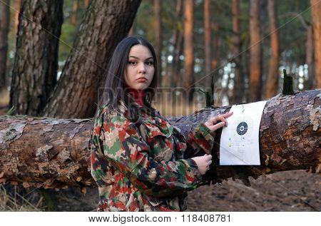 Civilian girl is practicing with her gun
