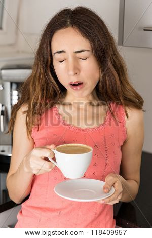 Tired Woman With A Cup Of Coffee