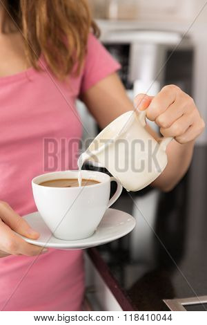 Adding Milk To The Coffee