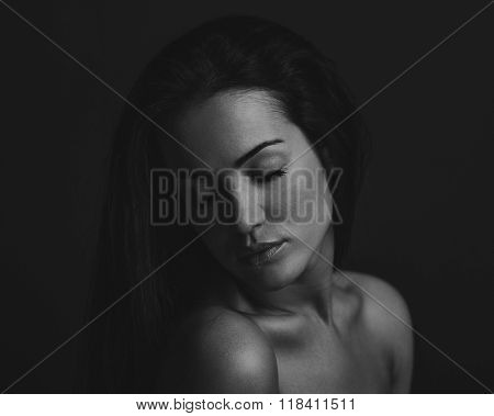 Dramatic Portrait Of A Girl Theme: Portrait Of A Beautiful Girl On A Dark Background In Studio