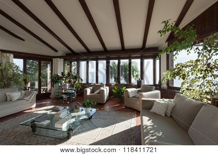 Interior; living room of a rustic house; divans and armchairs