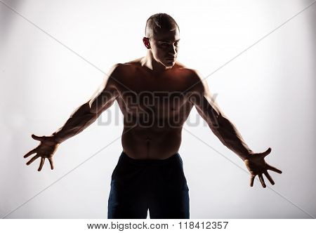 Silhouette Of Muscular Brutal Expression Man On White Background