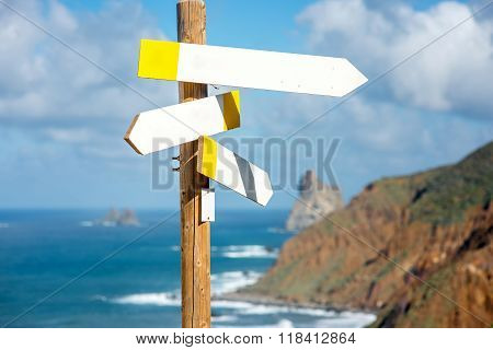 Wooden road sign with empty boards
