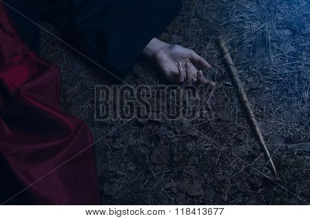 Girl With A Magic Wand Lying On The Ground