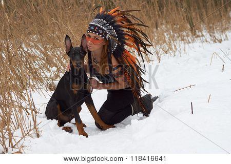 Girl In Headdress With Dog