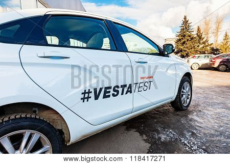 Vehicle Lada Vesta Near The Office Of Official Dealer. Lada Is A Russian Automobile Manufacturer