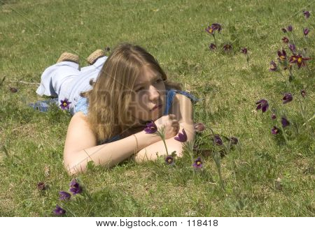 Girl And  Pasque-flowers