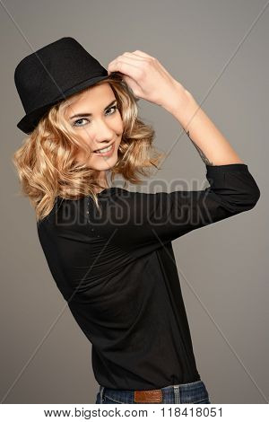 Portrait of a beautiful smiling blonde woman over gray background.  Beauty, fashion. Make-up, smoky eyes.
