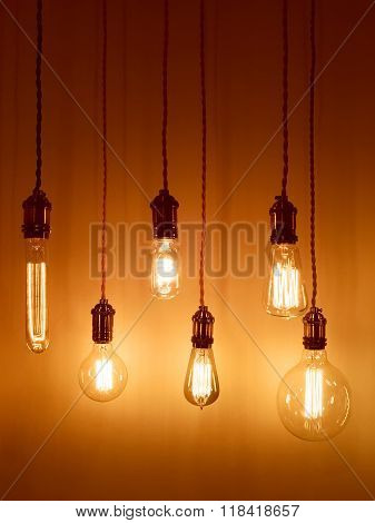 Light Bulbs On Warm Orange Background