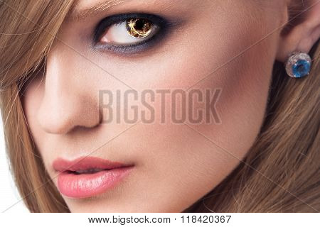 Portrait of beautiful woman with burning eyes