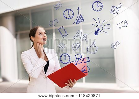 Business woman with icons overhead