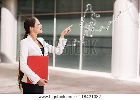 Business woman point on climbing person