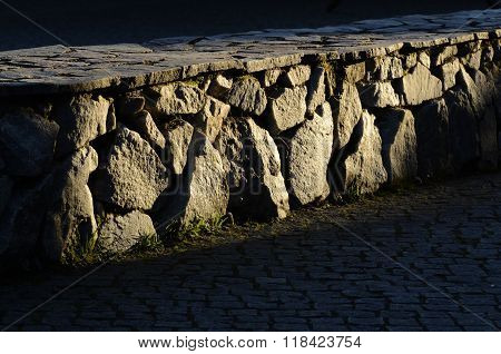 Low Stone Wall And Cobblestones