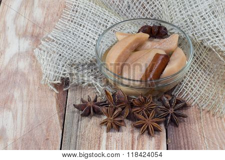 Pear Compote On Wooden Table With Star Anise & Cloves