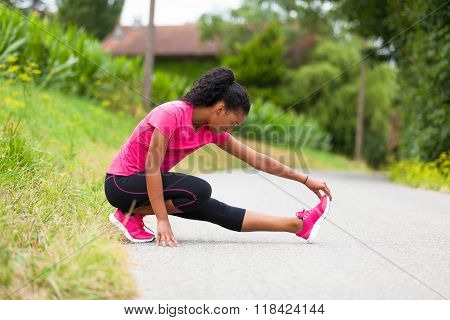 African American Woman Jogger Stretching  - Fitness, People And Healthy Lifestyle