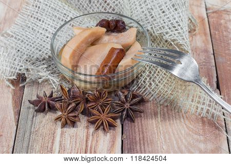 Pear Compote With Fork On Wooden Table With Star Anise & Cinnamon
