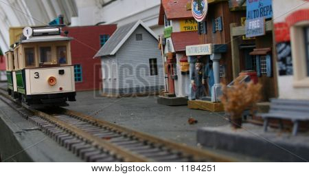 Model Trolley Car And Village