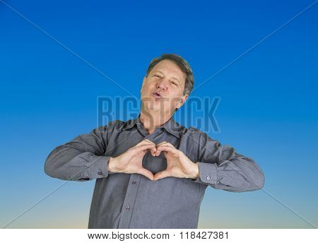 Man Gives A Kiss In The Air And Shows Heart Sign With Hands