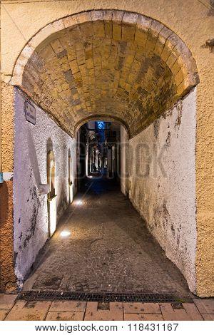 Narrow street passage at Carloforte harbor, San Pietro island, Sardinia