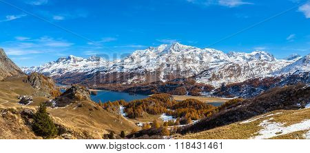 Panorama View Of Sils Lake In Golden Autumn