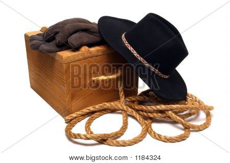 American West Rodeo Cowboy Hat and Old Ranch Tools