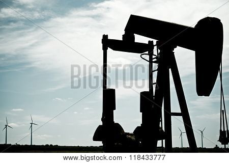 Oil well and windmills in Ayoluengo de la Lora, Burgo Province, Castilla Leon, Spain.