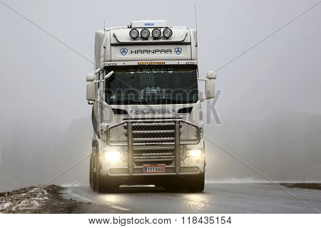 Front View Of White Scania Truck In Fog