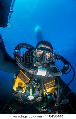 SCUBA diver on CCR underneath a boat