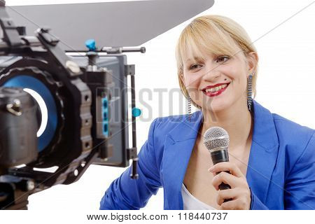 Portrait Of Elegant Woman Tv Reporter , Who Is Smiling And Looking Straight At The Camera