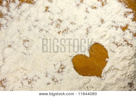 heart shape in a flour