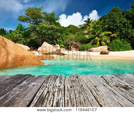 Beautiful beach and old wooden pier at Seychelles, Praslin, Anse Lazio