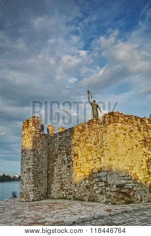 The port of Nafpaktos town and monument over Castle wall, Greece