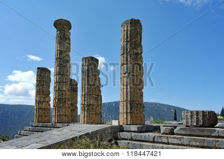 Cloudscape with The Temple of Apollo in Ancient Greek archaeological site of Delphi, Greece