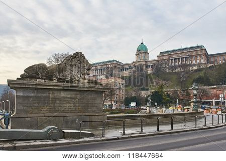 BUDAPEST, HUNGARY - FEBRUARY 02: Lion statue over Szechenyi Chain Bridge with Buda Castle in the background. February 02, 2016 in Budapest.