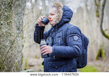 Man drinking tea in park