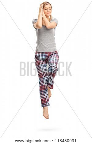 Full length portrait of a young woman peacefully sleeping shot in mid-air isolated on white background