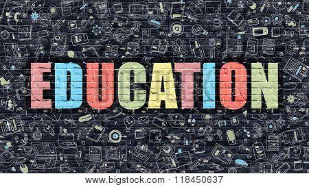 Education on Dark Brick Wall.