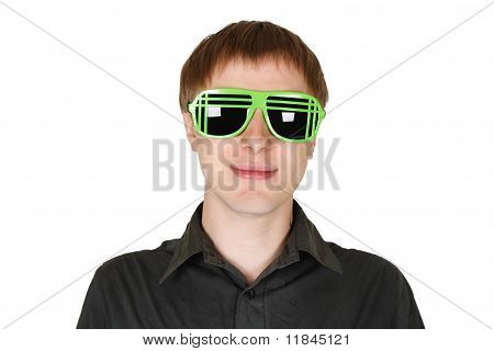 Young Man In Modern Club Sunglasses Smiling Isolated