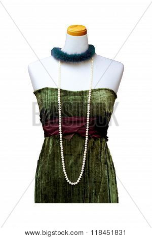 Female Dress With Pearls On A Mannequin Isolated On White Background