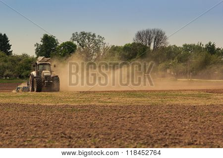 Cultivator Operates On Ploughed Field Raises Dust In Spring