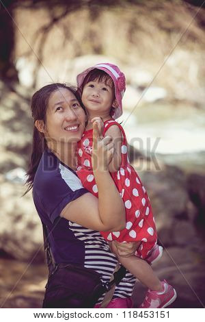 Asian Mother And Lovely Daughter In Holiday. Retro Style.